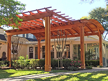 Construction Heart redwood beams and timbers form a graceful pergola.