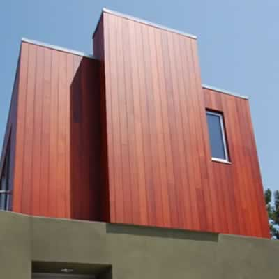 All heartwood redwood siding applied vertically on a modern home.