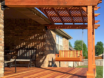 B Grade redwood decking and a beautiful, curved railing with built-in bench makes a perfect outdoor space.