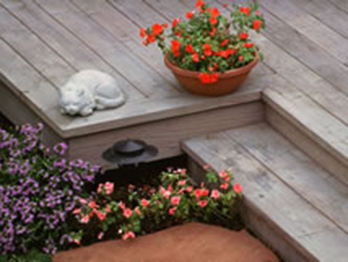 Redwood decking weathered to a silver gray color.
