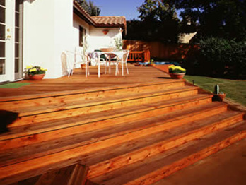 Knotty Construction Heart decking is used for the deck and steps on this Spanish style home.