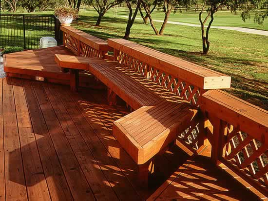 Redwood deck, rail and built-in bench overlooks a golf cource.
