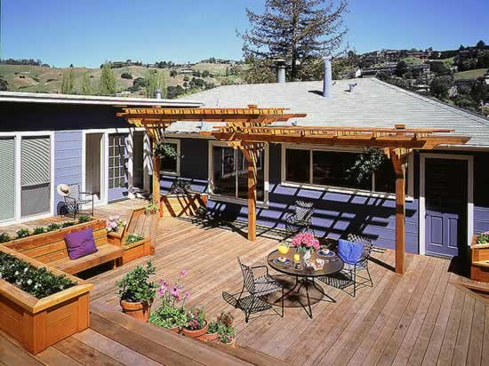 Redwood multi-level deck with built-in planters and bench.