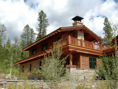 Redwood beams and timbers are integral tthe design of this mountain home.