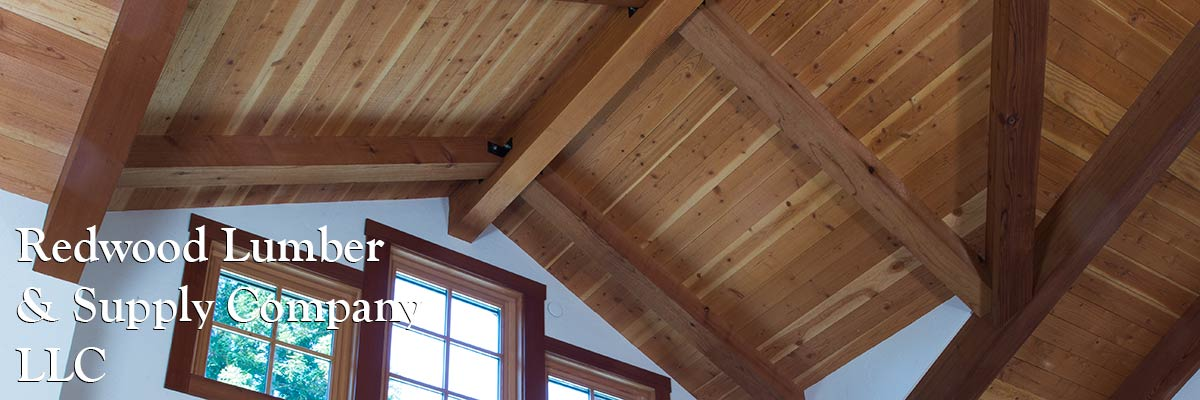 Redwood beams supporting a beautiful wood ceiling.