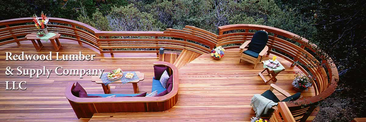 A redwood deck with built-in bench and an elaborate curved rail.