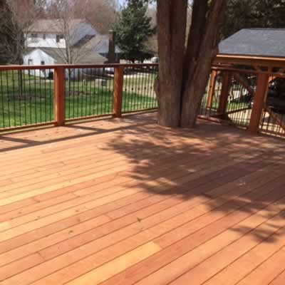 Redwood decking built around a large tree.